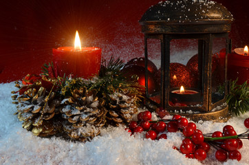xmas night red candles light in the dark and snow