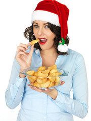 Young Woman in Santa Hat Holding Bowl or Cooked Roast Potatoes