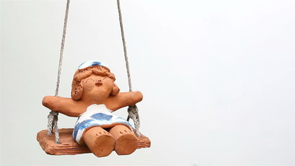 Children clay doll on white background.