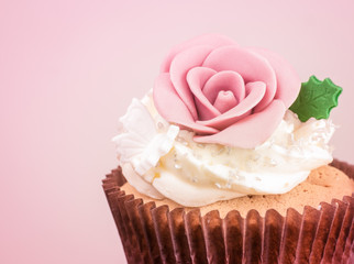 Sweet cupcake processed in pink tone