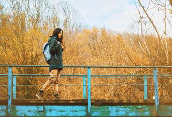 Hiker woman walking on bridge outdoor