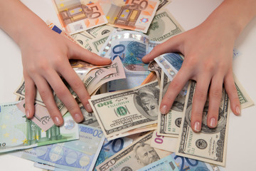 women can enjoy money in euros and dollars lying on the table