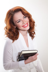 portrait of business woman in white jacket with diary
