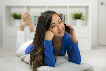 Young Asian woman listening on the phone