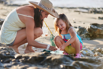 mother daughter fishing beach
