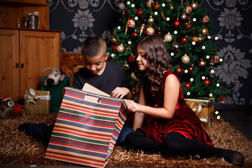 Happy children opening a Christmas present