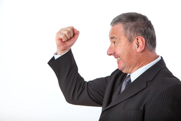 Serious businessman clenches his fist with joy