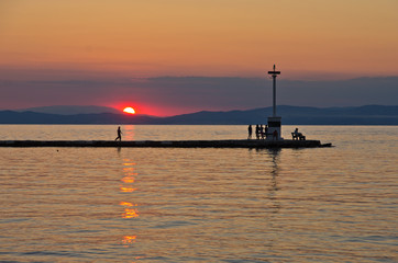 Lighthouse in Limenas harbour at sunset, island of Thassos