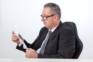 Man reading instruction manual on the desk