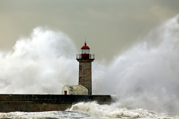 Stormy waves over lighthouse