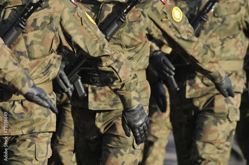 polish soldiers marching - 73816649