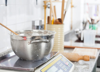 Mixing Bowl On Weight Scale In Commercial Kitchen