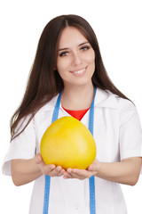 Nutritionist Holding a Pomelo Fruit