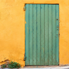 Green door on yellow wall in Provence