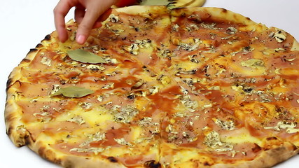 Decoration of fresh baked pizza