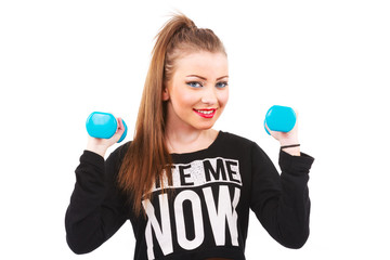 Happy fitness woman lifting dumbbells smiling cheerful, fresh an