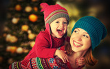 happy family mother and little daughter playing in Christmas - Fine Art prints