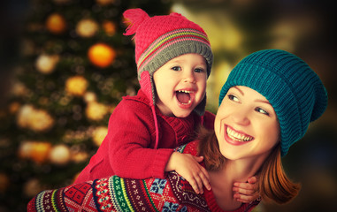 happy family mother and little daughter playing in Christmas