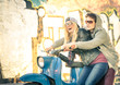 Young couple in love haviing fun on a vintage scooter moped - 73819628