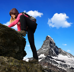 Girl on rock, in the background mount Matterhorn
