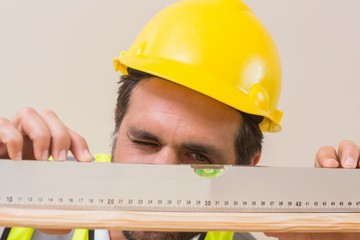 Construction worker using spirit level
