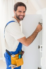 Handyman fixing a wardrobe