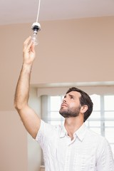 Man replacing the light bulb
