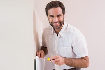 Handyman hanging up a radiator