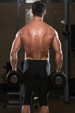 Fit Athlete Doing Exercise For Trapezius poster