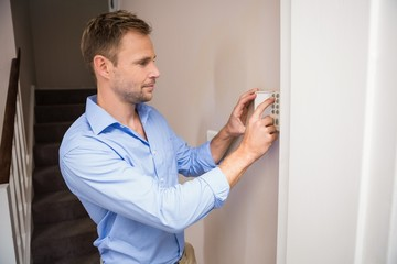Man arming a home alarm