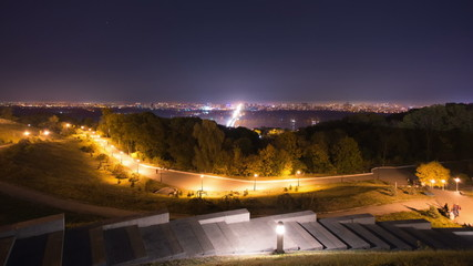 The city light by the autumn park background