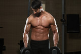 Male Athlete Doing Heavy Weight Exercise For Trapezius poster