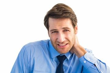 Businessman having a sore neck
