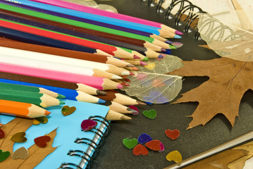 pencils, notebooks, autumn leaves