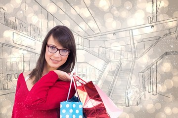 Composite image of happy brunette holding shopping bags