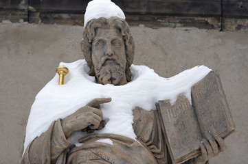 snowy statue of Saint