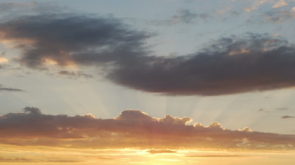 Heavenly clouds with sun rays