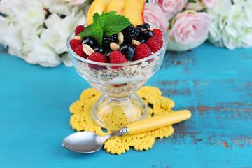 Healthy breakfast - yogurt with  fresh fruit, berries and