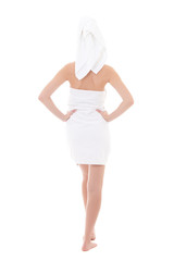 rear view of young beautiful woman wrapped in towel isolated on