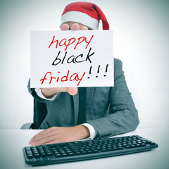 man with a signboard with the text happy black friday