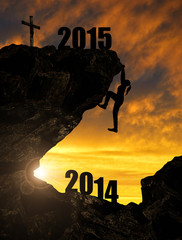 Silhouette girl climbs into the New Year 2015