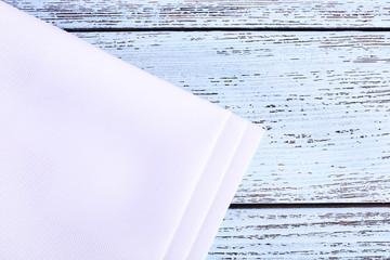 White napkins on wooden table