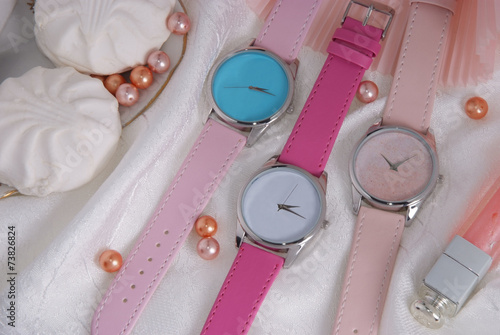 colorful watches on pink girlish background
