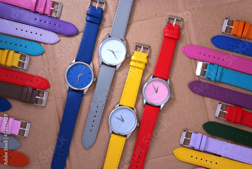 colorful set of watches on cardboard background - 73826829