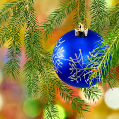 image of blue Christmas ball on a green background