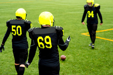Men playing american football