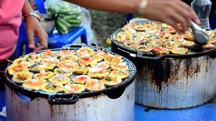 Kind of Thai sweetmeat Kanom Krok Seafood