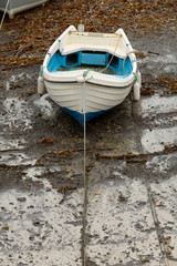 Small white fishing boat in harbour