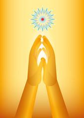 golden hand praying