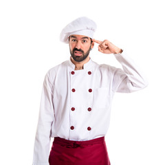 Chef making crazy gesture over white background